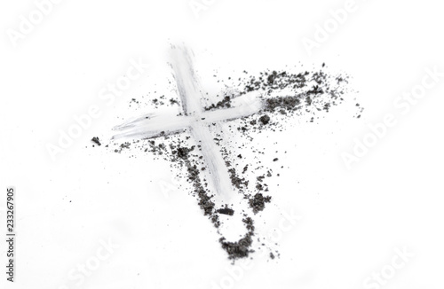 Fotografiet Christian cross or crucifix drawing in ash, dust or sand as symbol of religion,