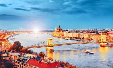 Fototapeta na wymiar Budapest, Hungary, Europe. Picturesque view over Danube river delta at old Budapest town and bridges. Panoramic landscape. Amazing illuminated night big city. Budapest is iconic UNESCO landmark.