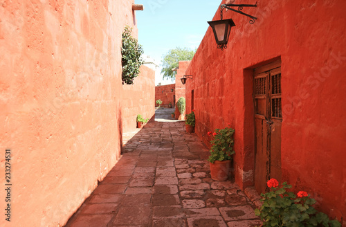 Recess Fitting Brick Cobblestone path among red and orange color old buildings in the Monastery of Santa Catalina, Arequipa, Peru