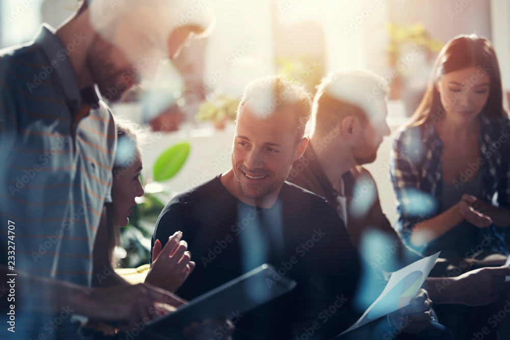Fototapeta Business people connected on internet network with a tablet. concept of startup company. double exposure