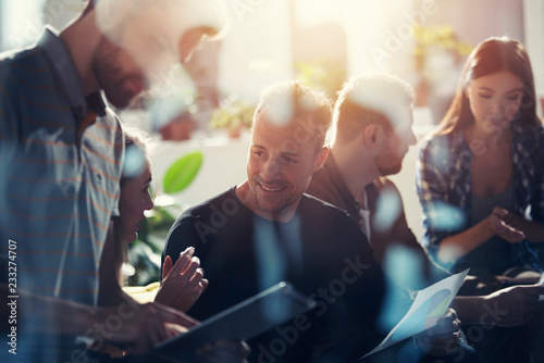 Business people connected on internet network with a tablet. concept of startup company. double exposure