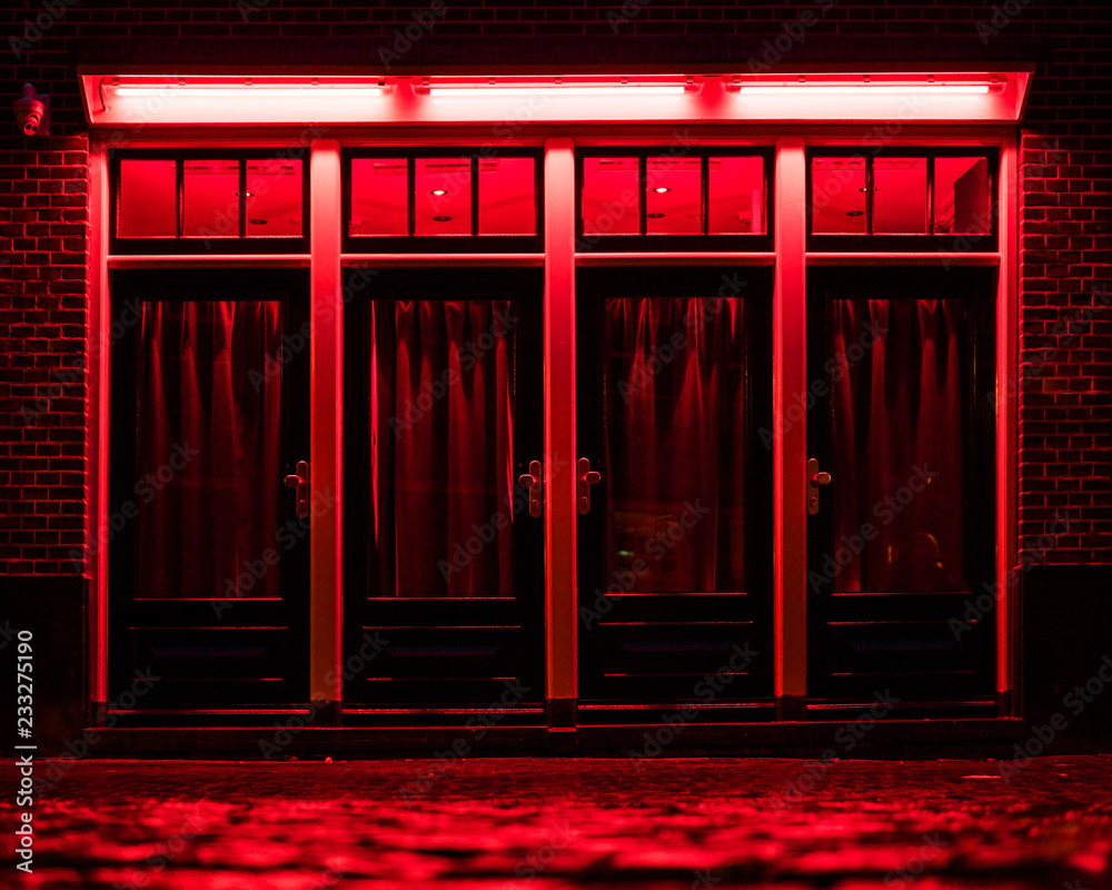 Fototapety, obrazy: Red Light District in Amsterdam. Red boxes with curtains and wet Cobbles on the street
