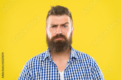 Are you serious. Man serious face raising eyebrow not confident. Have some doubts. Hipster bearded face not sure in something. Doubtful bearded man on yellw background close up. Doubtful expression