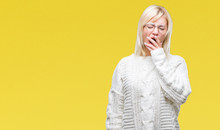 Young Beautiful Blonde Woman Wearing Winter Sweater And Glasses Over Isolated Background Bored Yawning Tired Covering Mouth With Hand. Restless And Sleepiness.