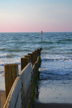 Breakwater And Sea Marker With...