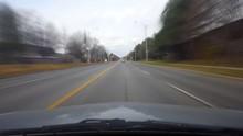 Driving Through A Suburban Int...