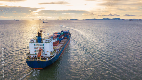 Cargo ship in the sea with the sunset