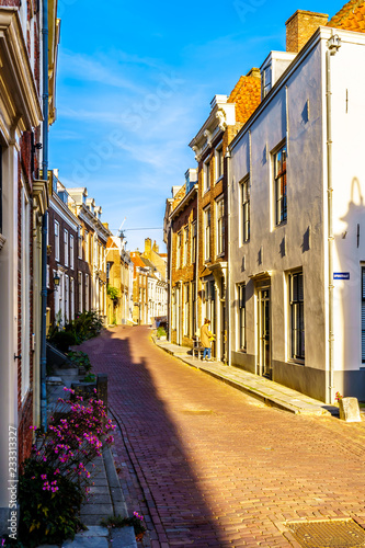 unset over Narrow Streets in the Historic City of Middelburg in Zeeland Province, the Netherlands