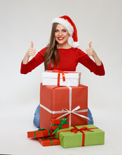 Portrait Of Smiling Girl Wearing Christmas Hat Show Thumbs Up