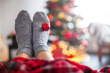 Knitted Socks On Christmas Tree Background