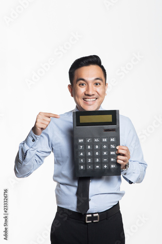 Man pointing to big calculator - 233326716