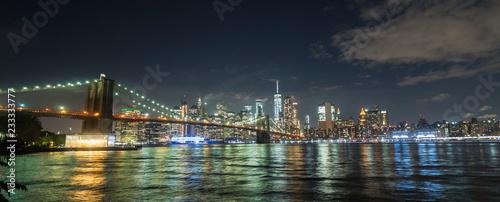Beautiful Brooklyn Bridge on the background of the night New York cityscape