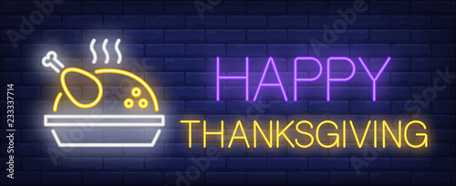 Fototapeta Happy thanksgiving neon text with roasted turkey. Thanksgiving Day advertisement design. Night bright neon sign, colorful billboard, light banner. Vector illustration in neon style. obraz