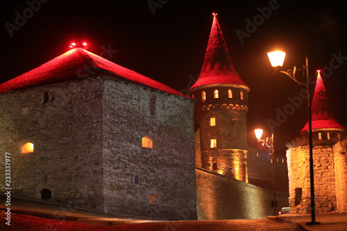 Valokuva  Old castle at night, stone fortress in Kamianets-Podilskyi city, western Ukraine