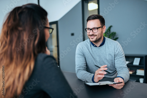 Female person having a job interview with a male recruiter.