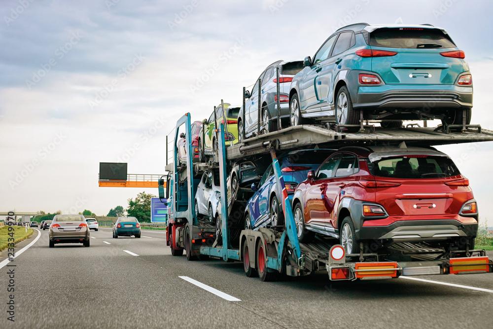 Fototapeta Cars carrier truck at asphalt highway road in Poland