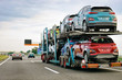 canvas print picture - Cars carrier truck at asphalt highway road in Poland
