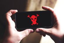 Red Pirate Skull On Smartphone Screen