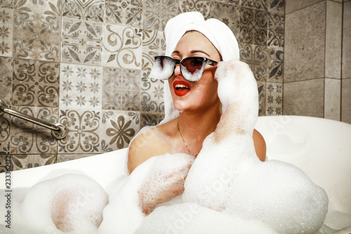 Woman in bath and towel on head. Canvas Print