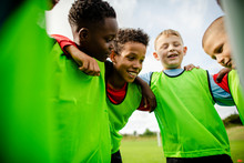 Junior Football Team Huddling ...