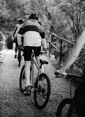 Fototapeta Friends cycling together in the countryside