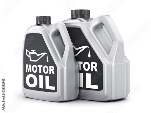 Photo  Two can motor oil on white background