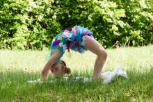 A Little Girl Doing A Yoga Bac...