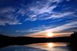 Summer sunset lake landscape over the Wejsunek lake in Wejsuny in Masuria region in Poland