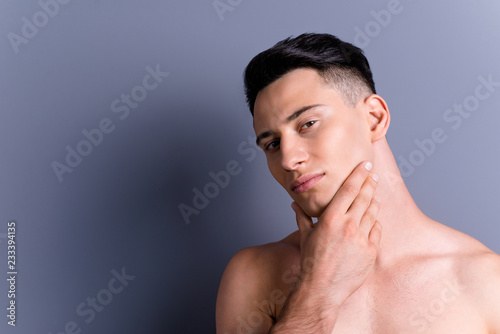 Close up portrait of brunet brutal man touch cheek look at camer Canvas Print