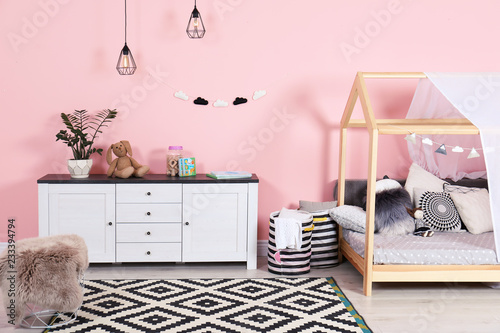 Modern child's room interior with cute bed Canvas Print