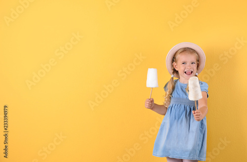 Fotografie, Obraz  Cute little girl with cotton candies on color background