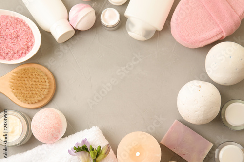 Canvas Print Flat lay composition with bath bombs, toiletries and space for text on grey back