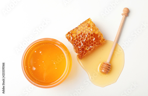 Fotografering Composition with fresh honey on white background, top view