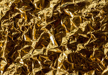 Crumpled Gold Foil Texture Background
