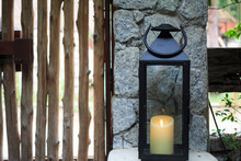 Wooden Lamp Near Wooden Door And Fence