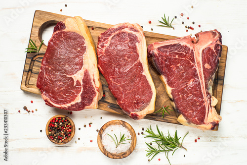 Poster de jardin Viande Raw meat beef steak on white top view.