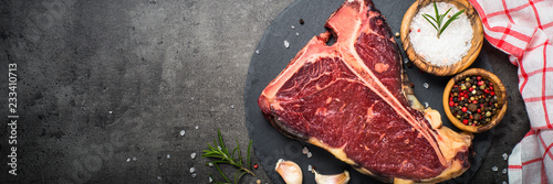 T-bone beef steak on black with spices. Wallpaper Mural