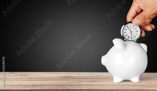 Papel de parede  Hand depositing  clock  in piggy bank on background