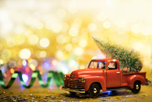 Christmas Red Truck With A Christmas Tree
