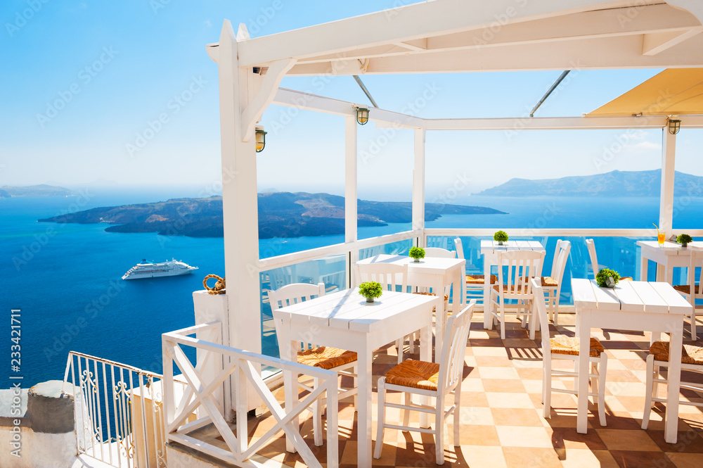 Fototapety, obrazy: Cafe on the terrace overlooking the sea. Santorini island, Greece