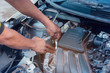 Car mechanic working with wrench in garage. Repair service.
