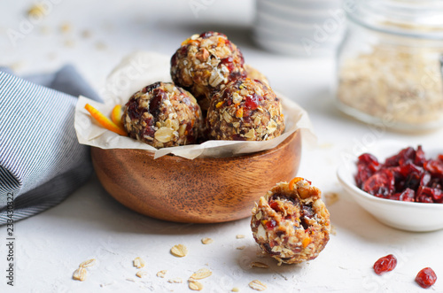 Photo Stands Dessert Healthy Energy Balls, Raw Vegan Balls with Oatmeal, Cranberry, Dates and Nuts