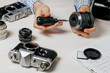 Repair of photographic equipment. Engineer - technician engineer disassembling, align and adjusts photo camera lens, optic part.