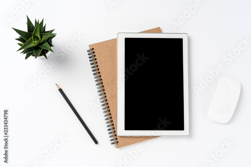 Fotografia  Modern office desktop with white digital tablet and copy space