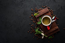 Black Coffee In A Cup. On A Black Stone Background. Top View. Free Copy Space.