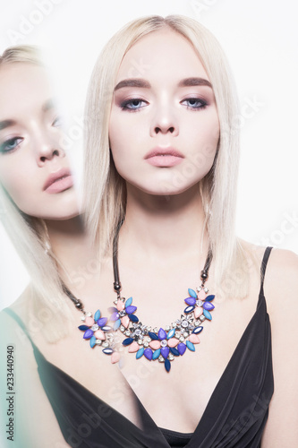 Poster womenART Beautiful young blonde in classic black dress and modern jewelry