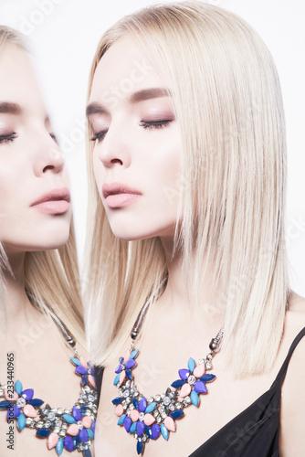 Foto op Plexiglas womenART Beautiful young blonde in classic black dress and modern jewelry