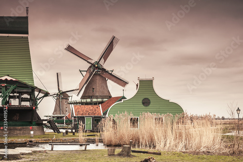 Foto op Canvas Europese Plekken Old wooden barns and windmill on Zaan river