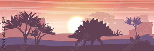 Leinwand Poster Silhouette of a large stegosaurus against the background of trees and rocks