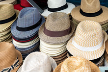 Stack Of Many Stacked Fedora Man, Men, Male Hats On Retail Display Of Street Seller, Vendors With Many Colors, Colorful In Florence, Firenze, Italy, Italian City